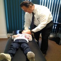 Dr. T treating toddler for ear infections